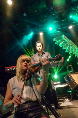 A Vision in Green: Anna Bulbrook and Steven Chen of The Airborne Toxic Event at The Fillmore. Photo by Stan Silverman, Sept. 2014.