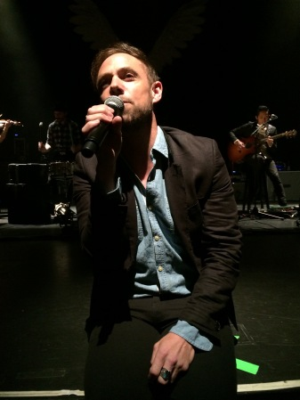 Mikel Jollett gets up close and personal during The Airborne Toxic Event's acoustic set in Washington, DC. Photo by Jamie, Oct. 2, 2014.