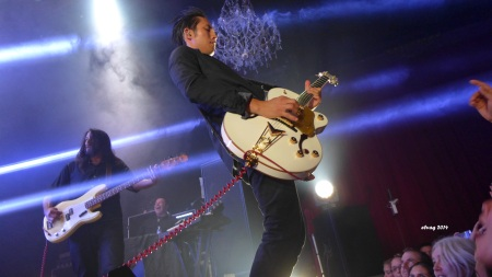 Steven Chen of The Airborne Toxic Event breaks in a new axe at The Fillmore. Photo by Elva, Sept. 18, 2014.