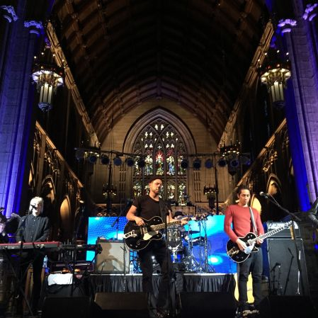 The Airborne Toxic Event soundchecks against a sacred backdrop. Rick Schanz. Cathedral Concert Series, Trinity Cathedral, Cleveland, OH, Mar. 13, 2015. https://www.flickr.com/photos/128689110@N03/sets/72157649018519484/with/16814913185/.