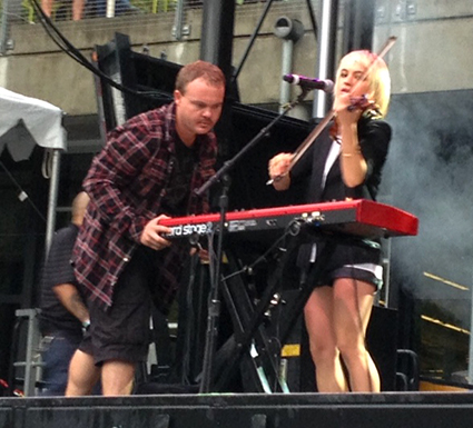 "Members of The Airborne Toxic Event crew worked to restore power to Anna Bulbrook's keyboard while she and the band ripped through ""What's in a Name?"""